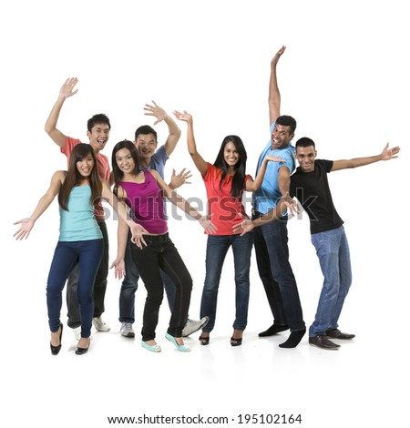 Large Happy group of Asian friends dancing. Isolated over white background - stock photo