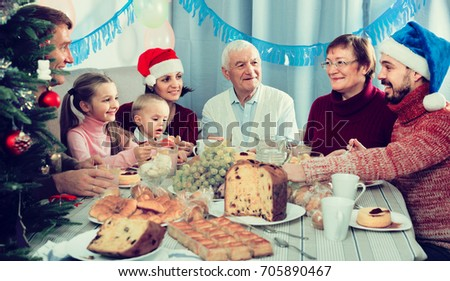 Large Happy Spanish Family Talking Animatedly During Christmas Dinner
