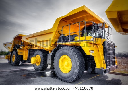 Large haul truck ready for big job in a mine. Low saturation and added vigneting. - stock photo