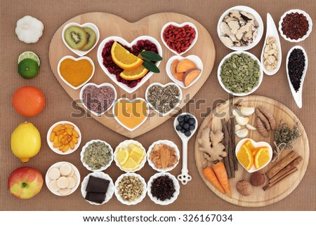 Large health food for cold cure high in antioxidants and vitamin c with supplement capsules and medicinal herbs and spices. - stock photo