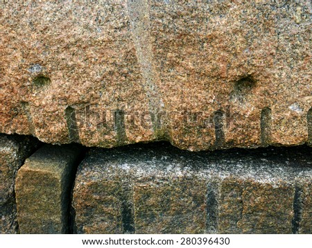 Large hewn granite stones for a seawall. - stock photo