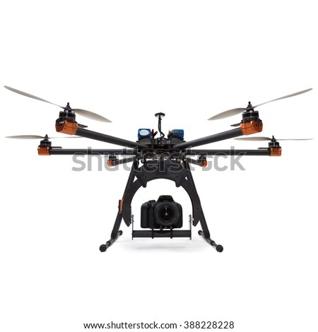Large hexacopter with DSLR camera at studio - stock photo