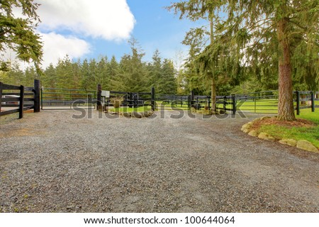 Large horse farm property with three gates. - stock photo