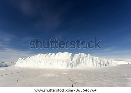 Large iceberg in the Antarctic - stock photo