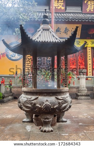 Large incense urn in front of the Jade Buddha Temple, Shanghai, China