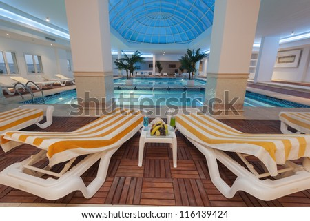 Large indoor sky pool at a luxury hotel with sunbeds