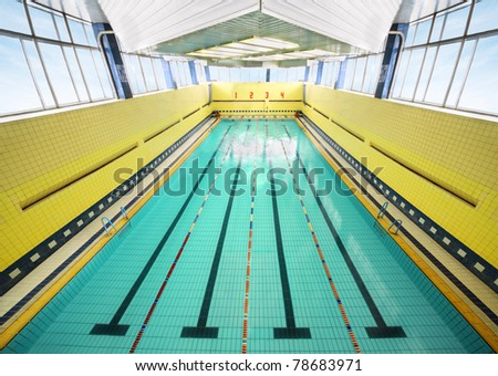 large indoor swimming pool, four bowling lanes, yellow walls, tile - stock photo