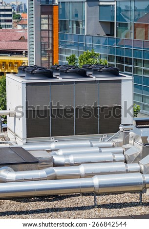 Large industrial air conditioners on the top of an office building - stock photo