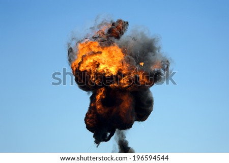 Large industrial fire with thick black smoke  - stock photo