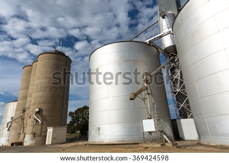 Large industrial Grain Silos made of steel - stock photo