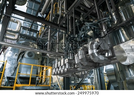 Large industrial pipes in a thermal power plant - stock photo