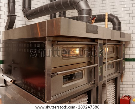 Large industrial pizza oven in restaurant - stock photo