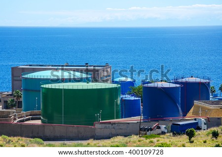 Large  Industrial tanks for petrol and oil near the sea - stock photo