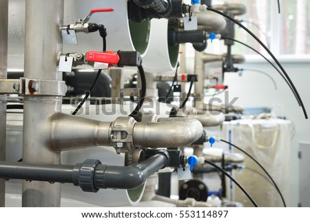 Large industrial water treatment and boiler room. Armature, pipes, valves, tags.