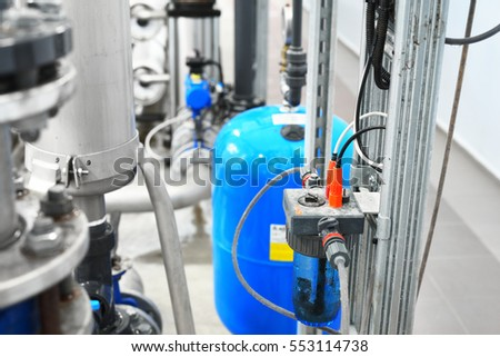 Large industrial water treatment and boiler room. Pipes, pressure vessels, armature