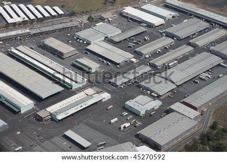 Large integrated warehouse and logistics distribution hub for loading and unloading of trucks. - stock photo