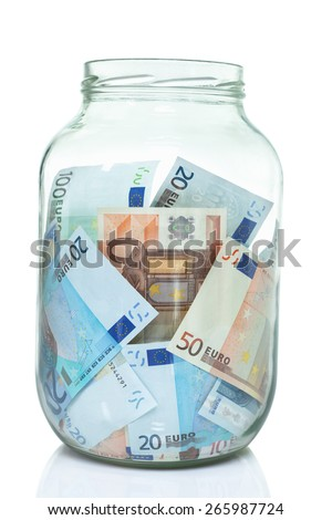 Large jar of Euro bills stuffed inside - stock photo