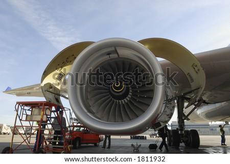 large jet engine turbine being serviced turbine engine mechanic