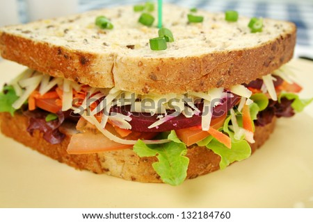 Large jumbo garden salad sandwich with beetroot and cheese ready to serve. - stock photo