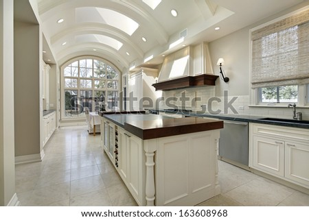 Large kitchen in luxury home with curved ceiling - stock photo