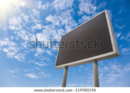 Large LCD screen under blue sky - stock photo
