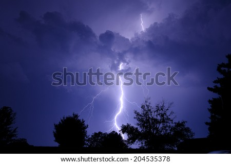 Large lightning bolt at night. - stock photo
