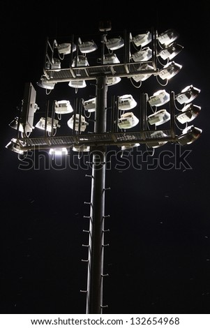 Large lights over a sports arena - stock photo