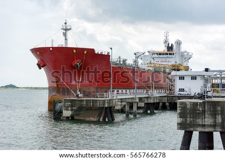 Large liquid cargo vessel docked at the jetty near Tanjung Langsat Port, Johor, Malaysia.