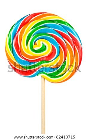 Large lollipop on stick isolated on white - stock photo