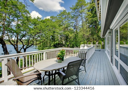 Large Long Balcony Home Exterior Table Stock Photo