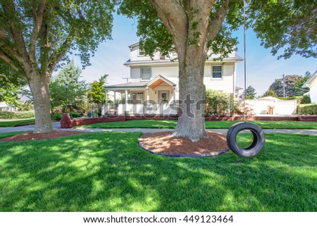 Large luxury beige craftsman classic American house exterior. View from the garden - stock photo