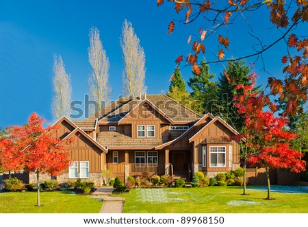 Large luxury home with blue sky  in sunny autumn day - stock photo