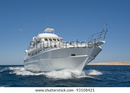 Large luxury motor yacht under way out at sea - stock photo