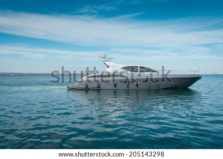 Large luxury  private motor yacht  out at sea - stock photo