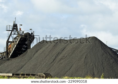 Large machinery creating manganese heaps ready for export - stock photo