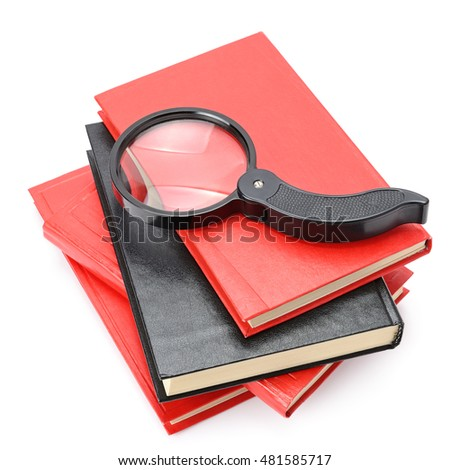 Large magnifier on book stack isolated on white.