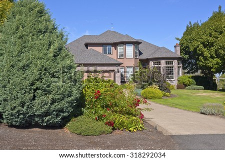 Large mansion with many plants in Happy Valley Oregon. - stock photo