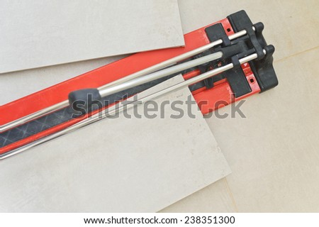 Large Manual Cutter For Ceramic Tiles and cut tiles - stock photo