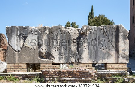Large marble blocks in the Roman Forum with an inscription dating to 2 BC referring to Lucius Caesar, grandson of Julius.  Concepts could include history, tourism, architecture, engraving, and others. - stock photo