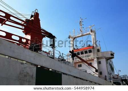 Large marine vessel with blue sky