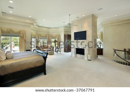 Large master bedroom in luxury home - stock photo