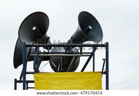 Large megaphone set on the metal frame for announcement in the rural village.