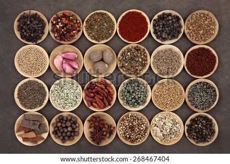 Large middle eastern spice selection in wooden bowls. - stock photo
