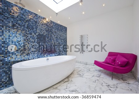 large modern porcelain bath and a magenta pink sofa - stock photo