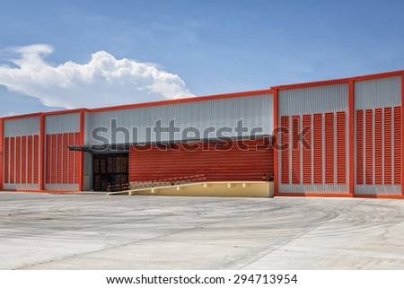 Large modern warehouse building - stock photo
