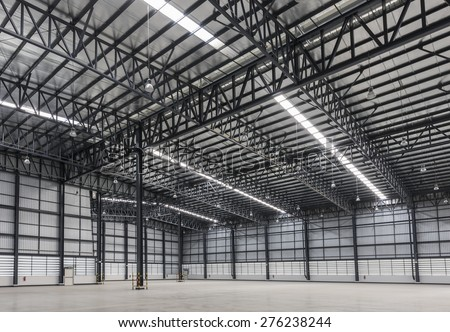 Large modern warehouse in logistic area - stock photo
