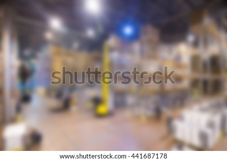 Large modern warehouse theme creative abstract blur background with bokeh effect - stock photo