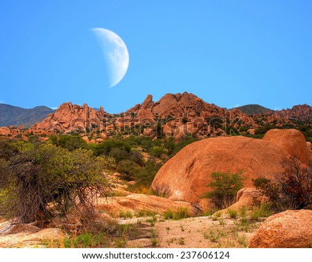 Large moon above Texas Canyon in Southeast Arizona - stock photo