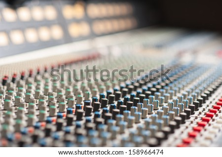 Large music mixer desk in recording studio - stock photo