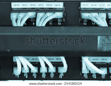 Large network hub connected Internet with LAN cables. - stock photo